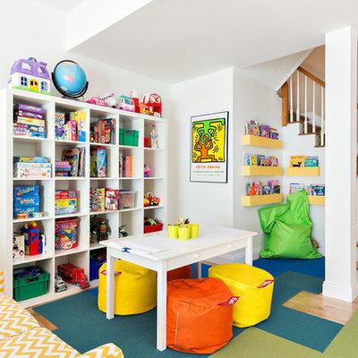 Elegant gender-neutral light wood floor kids' room photo in New York with white walls