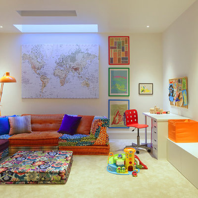 Playroom - contemporary gender-neutral carpeted playroom idea in London with white walls