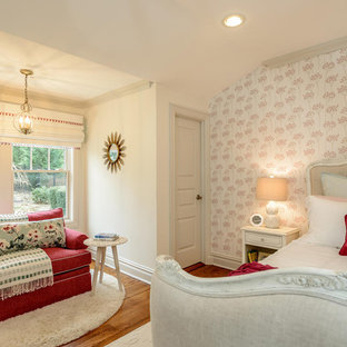 Mid-sized cottage chic girl carpeted and white floor kids' room photo with multicolored walls