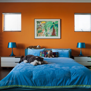 Example of an eclectic kids' room design in San Francisco with orange walls