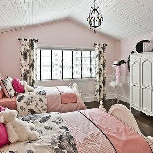 Example of a trendy girl kids' room design in Edmonton with pink walls