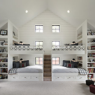 Country carpeted and beige floor kids' bedroom photo in Denver with white walls
