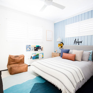 Contemporary kids' bedroom in Sunshine Coast with blue walls, carpet and black floor for kids 4-10 years old and boys.