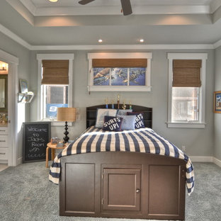 Elegant boy carpeted and gray floor kids' room photo in Los Angeles with gray walls