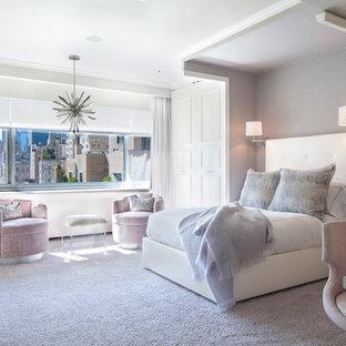 Modelo de dormitorio infantil clásico renovado con paredes blancas, moqueta y suelo gris
