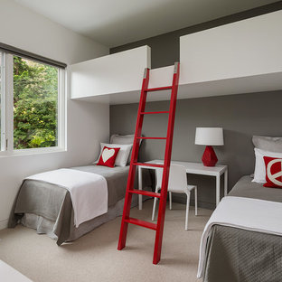 Inspiration for a mid-sized modern gender-neutral carpeted and beige floor kids' room remodel in Seattle with gray walls