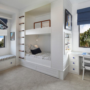 Inspiration for a beach style boy carpeted and gray floor kids' bedroom remodel in Orange County with white walls