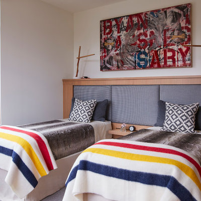 Example of a mid-sized transitional gender-neutral carpeted and gray floor kids' room design in San Francisco with white walls
