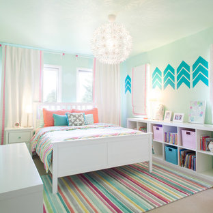 Example of a mid-sized trendy girl carpeted kids' room design in Portland with blue walls