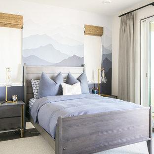 Example of a trendy boy medium tone wood floor kids' room design in San Diego with gray walls