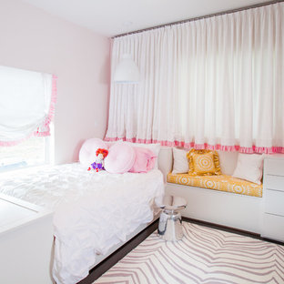 Trendy girl dark wood floor kids' bedroom photo in Houston with pink walls