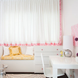 Inspiration for a contemporary girl kids' study room remodel in Houston with white walls