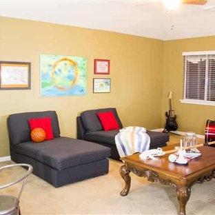 Example of a large classic boy kids' room design in Houston with yellow walls
