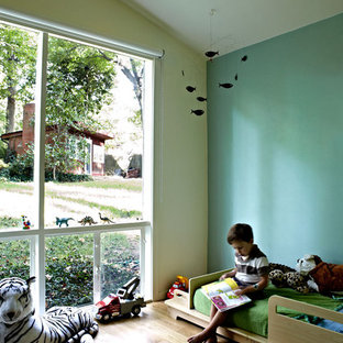 Inspiration for a 1950s boy medium tone wood floor kids' room remodel in DC Metro with multicolored walls