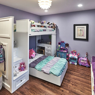 Design ideas for a large midcentury kids' bedroom for kids 4-10 years old and girls in San Francisco with purple walls, medium hardwood floors and brown floor.