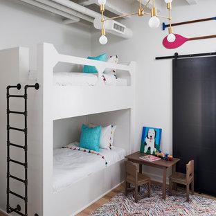 Kids' bedroom - industrial medium tone wood floor and brown floor kids' bedroom idea in Atlanta with white walls