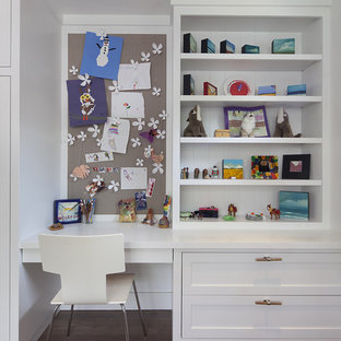 Example of a trendy girl dark wood floor kids' room design in San Francisco with white walls