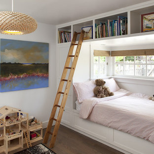 Kids' bedroom - contemporary gender-neutral dark wood floor kids' bedroom idea in San Francisco with white walls