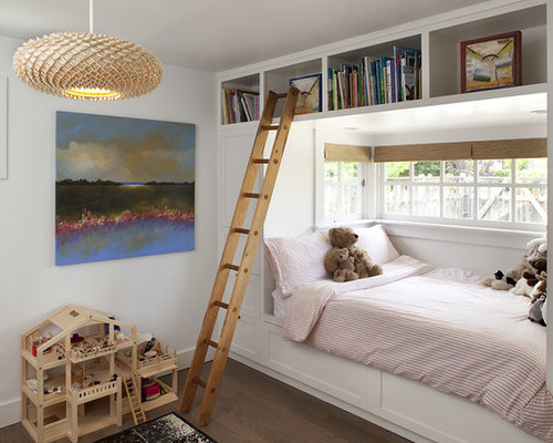 Contemporary gender-neutral dark wood floor kids' bedroom idea in San  Francisco with white