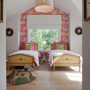 Inspiration for a country girl light wood floor kids' room remodel in San Francisco with multicolored walls