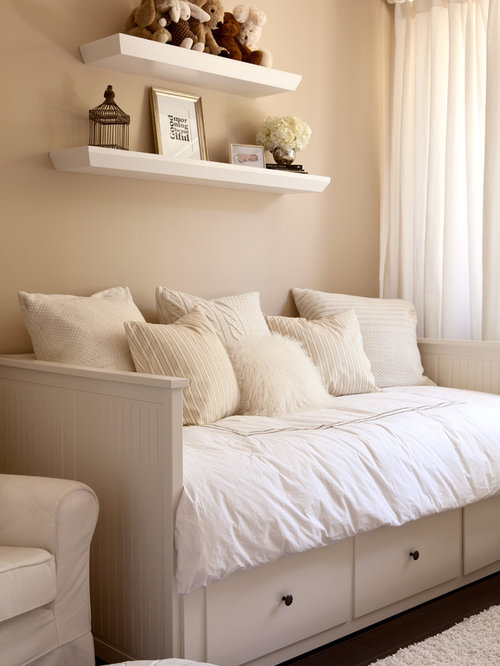 example of a transitional gender neutral kids room design in san francisco with beige - Day Bed Frames