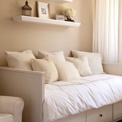 Example of a transitional gender-neutral dark wood floor kids' room design in Boise with beige walls