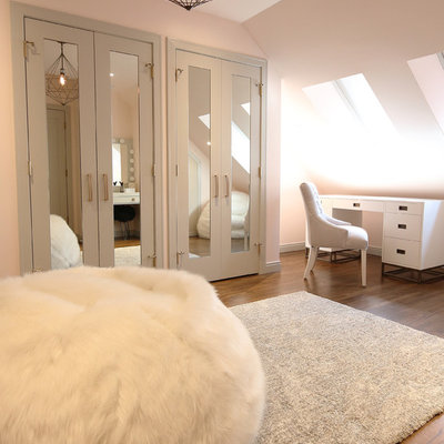 Example of a mid-sized minimalist girl dark wood floor and brown floor kids' room design in Calgary with pink walls