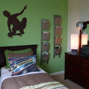 Example of an eclectic boy carpeted kids' room design in Santa Barbara with multicolored walls