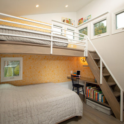 Mid-sized trendy gender-neutral brown floor kids' room photo in DC Metro with gray walls