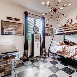 На фото: детская среднего размера в стиле лофт с спальным местом, серыми стенами и черным полом для мальчика, ребенка от 4 до 10 лет с