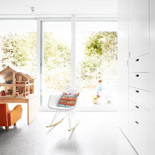 Bild på ett funkis barnrum, med betonggolv
