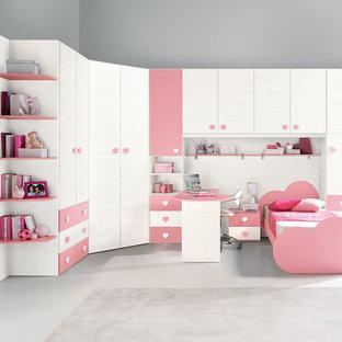 Ejemplo de dormitorio infantil moderno con escritorio
