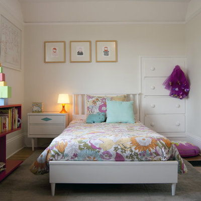 Kids' room - mid-sized contemporary girl light wood floor kids' room idea in Portland with white walls