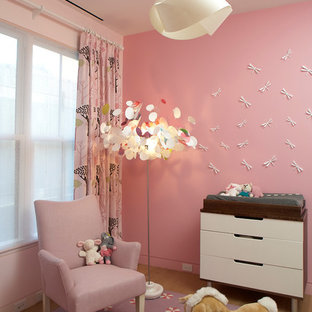 Kids' room - transitional kids' room idea in New York with pink walls