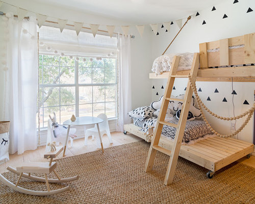 Small scandinavian gender neutral kids room idea in dallas with white