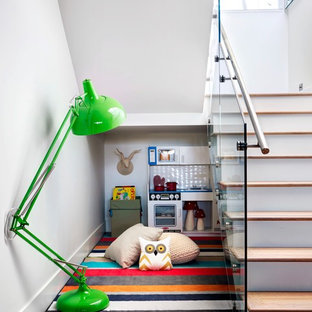 Farmhouse gender-neutral medium tone wood floor childrens' room photo in Calgary with white walls