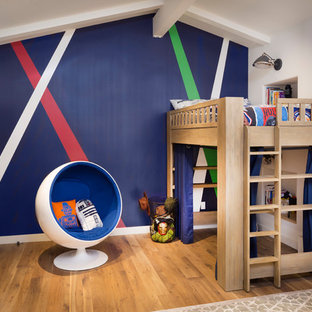 Example of a midcentury modern boy medium tone wood floor kids' room design in Los Angeles with multicolored walls