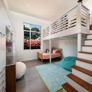 Design ideas for a medium sized contemporary children's room for girls in Santa Barbara with white walls, medium hardwood flooring and brown floors.
