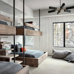 Kids' bedroom - rustic boy carpeted and beige floor kids' bedroom idea in Other with white walls