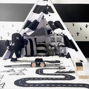 Inredning av ett nordiskt mellanstort pojkrum kombinerat med lekrum och för 4-10-åringar, med klinkergolv i porslin och flerfärgade väggar