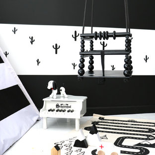 Example of a mid-sized trendy boy porcelain tile and white floor kids' room design in Las Vegas with black walls