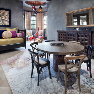 This is an example of a large mediterranean gender neutral kids' room in Houston with grey walls, marble flooring and beige floors.