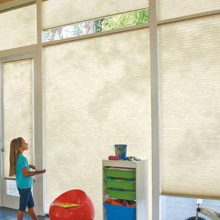 Esempio di una grande cameretta per bambini da 4 a 10 anni design con pavimento in ardesia