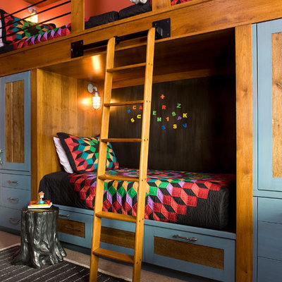 Mountain style kids' room photo in Denver with multicolored walls