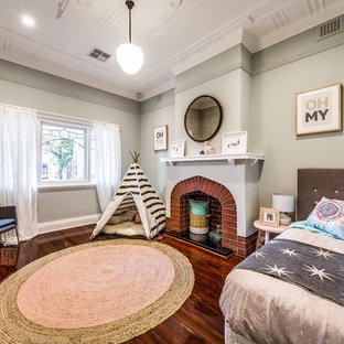 Photo of a large transitional kids' room for kids 4-10 years old and girls in Perth with medium hardwood floors and grey walls.