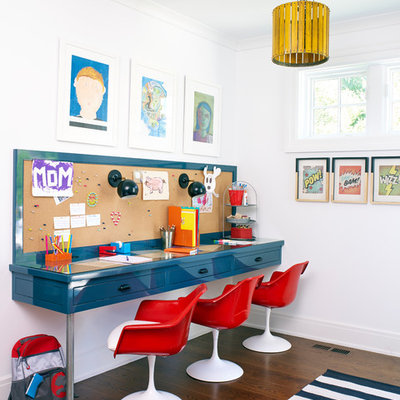 Example of a trendy gender-neutral dark wood floor and brown floor kids' study room design in New York with white walls