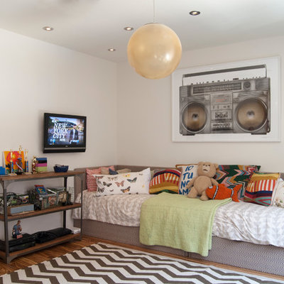 Kids' room - large contemporary boy medium tone wood floor kids' room idea in New York with white walls