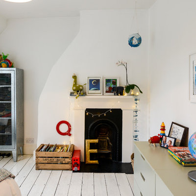 Inspiration for an eclectic painted wood floor and white floor kids' bedroom remodel in London