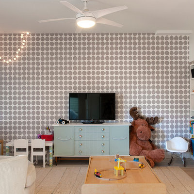 Inspiration for a contemporary boy light wood floor playroom remodel in Vancouver with multicolored walls