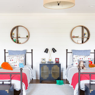 Inspiration for a large beach style gender-neutral dark wood floor kids' room remodel in Kansas City with white walls